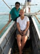 Julia with Journal, our Philippine Tourism Board assistant, on a bangka in Donsol.